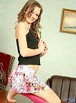 Top-quality nubile teen in skirt and pink legband posing and teasing nice